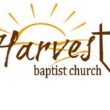 Harvest Baptist Church logo with a sun behind it