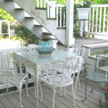 lower level patio with white table and chairs