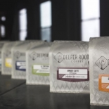 deeper roots bags of coffee