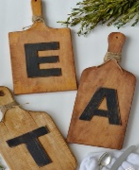 cutting boards with the word Eat
